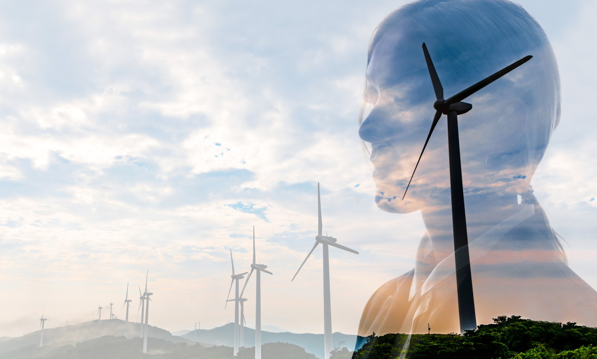 cleantech women image overlaying wind turbines